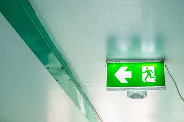 Emergency exit sign on interior building